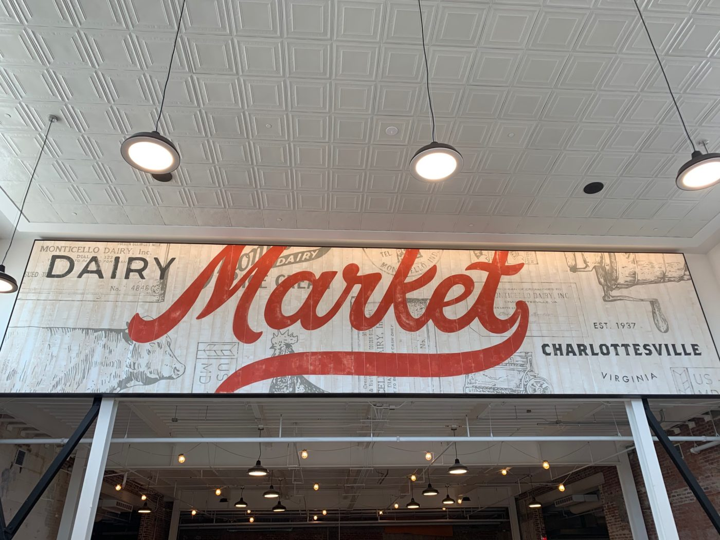 Entrance Sign to Dairy Market - says
